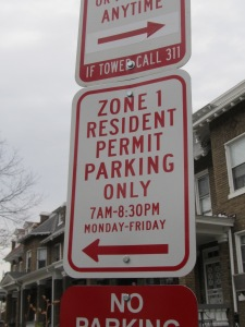 Enhanced parking sign limiting parking to area residents only.