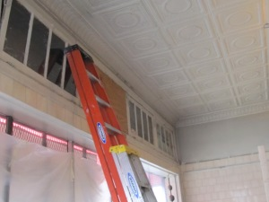 After removing the false ceiling, these clearstory windows were discovered which will be retained for additional light.