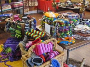 Knit hats and mittens in an assortment of colors at Tibet Shop, 3213 Georgia.