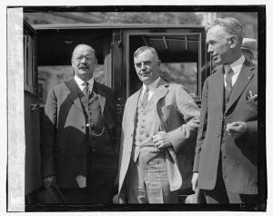 Senator Johnson (left) meeting Secretary Wallace (center) during Johnson's October 3, 1923, visit.