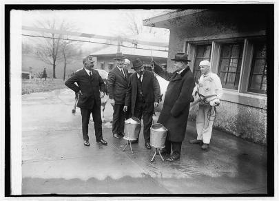 Maj. Gen. Tasker H. Bliss (second from right) measuring milk with Johnson (third from left) and Wallace (left) looking on.