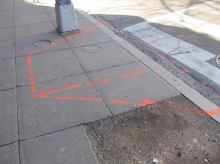 Sidewalk along Georgia Avenue marked for future new crosswalk.