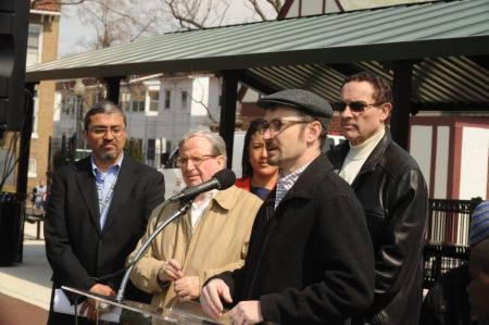 Commissioner Boese addressing the community, with Councilmember Graham and Mayor Gray, and DPR Director Aguirre in the background.