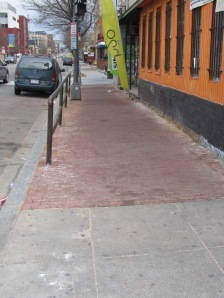 The brick sidewalk just north of Park Road has been replaced.