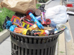 One of the many area trashcans filled with the remains of Fourth of July celebrations in 2013.