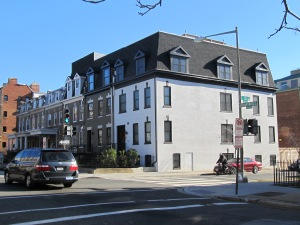 Over the past year, the houses on the southeast corner of Harvard Street, at 15th, have been slowly popping up. As each house falls like dominoes, the front porch is removed and the roof is raised. The house on the corner was the first to get renovated. The third house in was the last, and least compatible with the street.