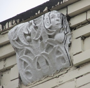 One of the two decorative corbels showing face detail.
