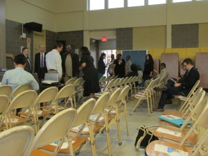 Participants of the Ward 1 DC Water town hall milling about prior to the meeting.