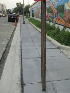 State of sidewalk work on Otis Place, evening of July 1, 2015.