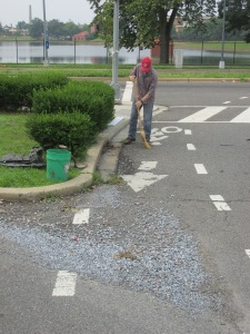 Beginning to clean up the gravel in the Warder Street bike lane.