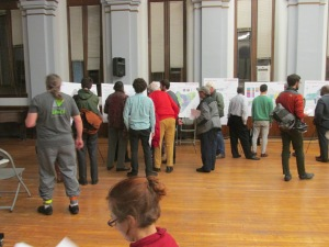 Residents examining the data boards at the February 2 Crosstown Multimodal Transportation Study.