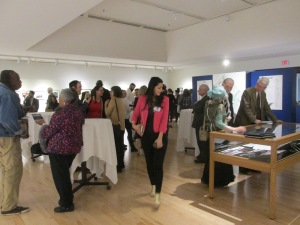 Visitors enjoying themselves at the opening of For the Record exhibition.