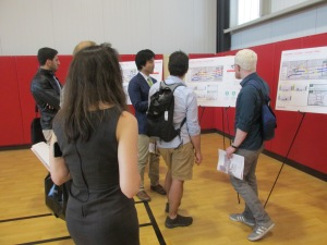 Residents reviewing some of the boards during the 2nd Crosstown workshop.