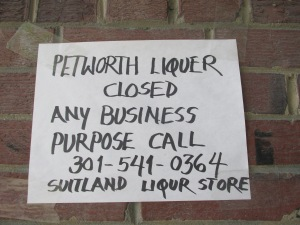 Sign posted outside of Petworth Liquor.