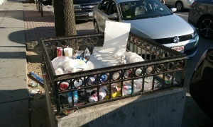 Photo of Metro ventilation grate full of trash, sent in by a reader.